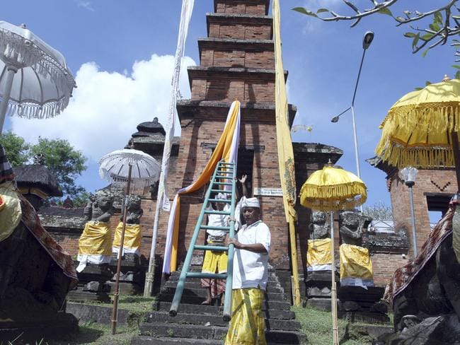 Locals are weary of structures that are too tall, due to a traditional beliefs governing height. Picture: AP/Firdia Lisnawati