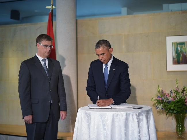 US President Barack Obama signs a condolence book at the Netherlands Embassy in Washington, DC. Picture: AFP