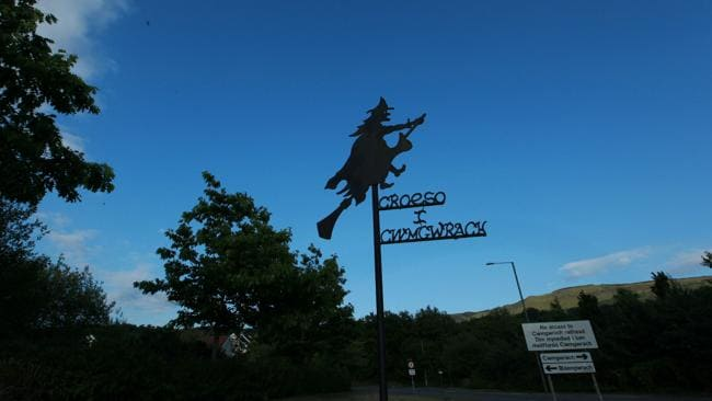 The witch on broomstick entrance sign to the tiny Welsh village of Cwmgwrach, Neath, translated as Valley of Witches.