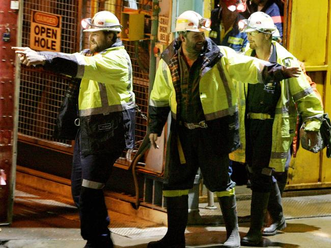 Tasmanian miners Todd Russell (L) and Brant Webb wave as they emerge from the mine lift having been rescued after being trapped underground at Beaconsfield gold mine for 14 days in 2006. Picture: AFP