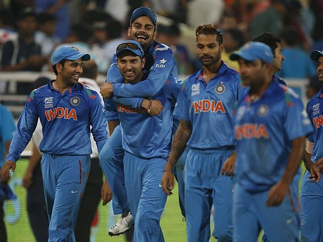 India's Yuvraj Singh, second left, carries teammate Virat Kohli on his back as they celebrate their win.