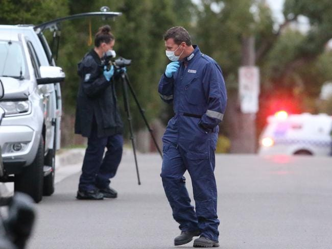 Forensic police at the scene. Picture: David Crosling