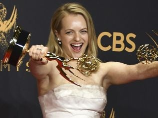 """TOPSHOT - Elisabeth Moss poses with the awards for Outstanding Drama Series and Outstanding Lead Actress in a Drama Series for """"The Handmaid's Tale"""" during the 69th Emmy Awards at the Microsoft Theatre on September 17, 2017 in Los Angeles, California. / AFP PHOTO / MARK RALSTON"""