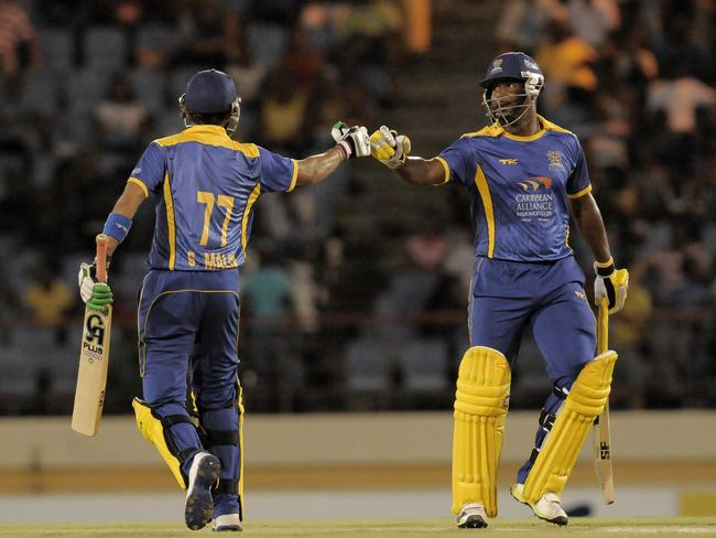 Shoaib Malik (L) and Dwayne Smith (R) set up the victory for Barbados Tridents.