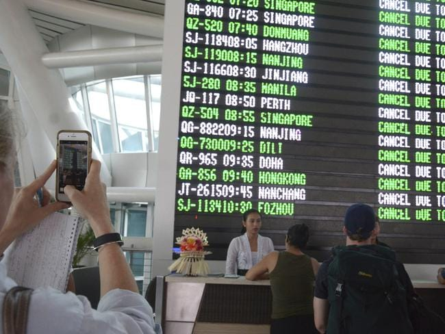 A flight information board shows cancelled flights at Ngurah Rai International Airport in Denpasar, Bali, Indonesia. Picture: AP Photo/Ketut Nataan.