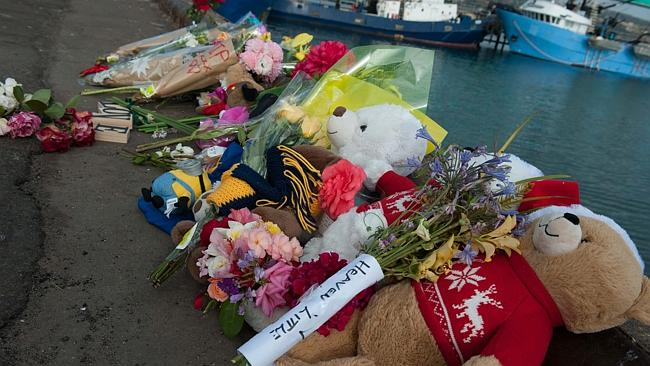 Teddy bears are part of the makeshift memorial on the wharf at Port Lincoln. Picture: Ivo