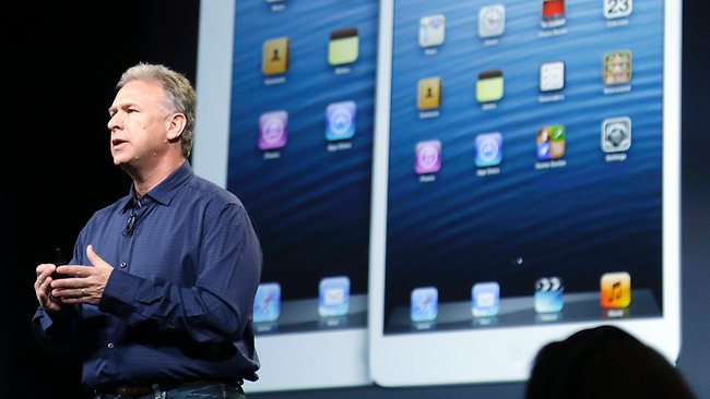 Phil Schiller, Apple's senior vice president of worldwide product marketing, speaks in front of an image of the 4th generation iPad, at left, and the iPad mini. Picture: Marcio Jose Sanchez