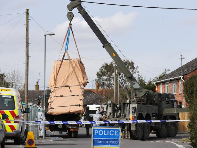 Forensic teams remove a recovery truck used in the aftermath of the Salisbury nerve agent attack. Mr Skripal and his daughter remain critically ill. Picture: Christopher Furlong/Getty Images