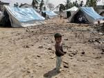 <p>Sri Lankan child, left homeless where area was devasted by Boxing Daytsunami tidal waves, stands outside a temporary refugee camp at the beachof town of Hambantota.</p>
