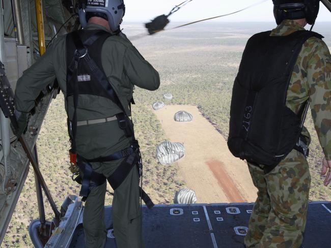 Hot drop ... Soldiers parachute from a C-130J Hercules during Exercise Pitch Black 2014. Unlike earlier relief operations in Iraq, the RAAF will not be parachuting supplies. It will, instead, be landing in Iraq's hotly contested northern regions. Source: Defence