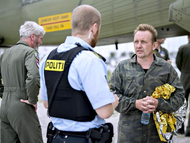 Peter Madsen talks with police soon after Kim Wall's disappearance last August. Picture: AFP/Scanpix Denmark/Bax Lindhardt