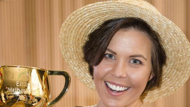 Nicole Slater with the Melbourne Cup at the VRC breakfast. PIC: Ben Vella