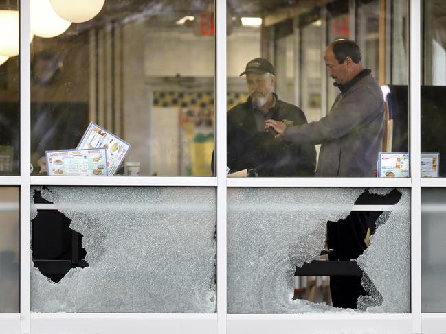 Investigators look over an area near a window shot out at the Waffle House restaurant in Nashville. Picture: AP