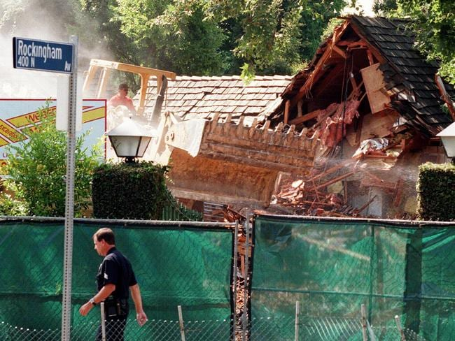 A bulldozer demolishes the Brentwood home formerly owned by OJ Simpson in 1998. Pictured: Supplied