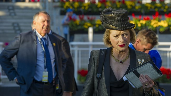 Keeping their distance: Gai Waterhouse walks away from John Singleton after More Joyous' unplaced run in the All Aged Stakes. Picture: Bronwen Healy