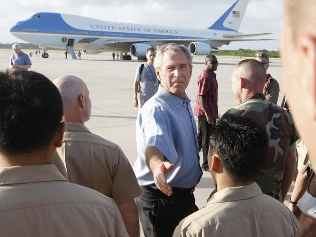 Stopover ... then US President George W Bush (c) greets military personnel during a refuelling stop for Air Force One in Diego Garcia in 2007.