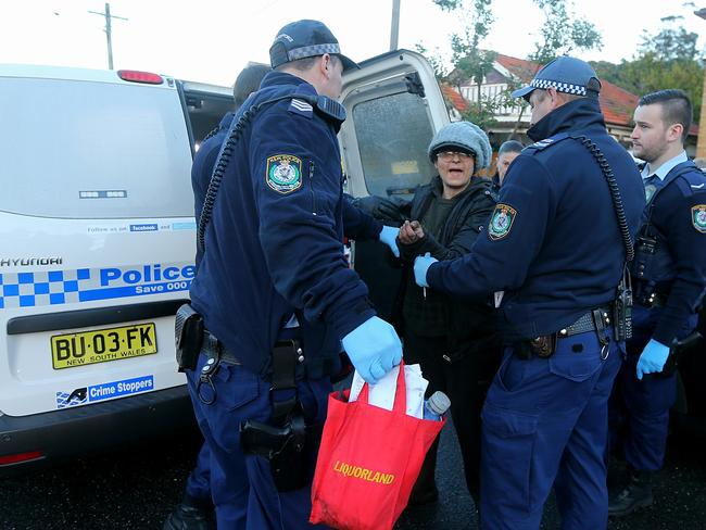 Liana Bobolas under police arrest during a council-ordered clean-up in 2015. Picture: John Grainger