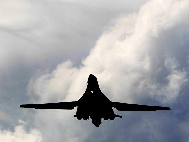 "A B-1B ""Lancer"" bomber flies with its wings swept forward for slow, low flight. Picture: News Corp"