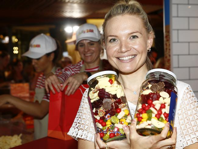 Samantha Terkalas loads up on lollies as Christmas presents. Picture: John Appleyard
