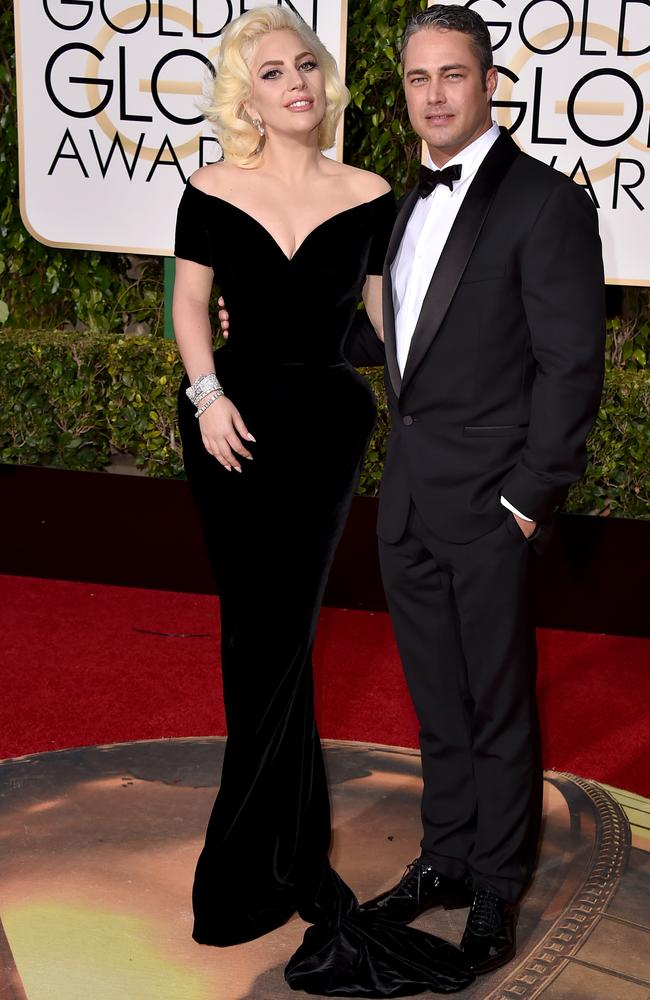 Lady Gaga and Taylor Kinney arrive at the 73rd annual Golden Globe Awards.