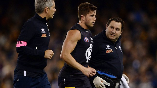 Marc Murphy makes his way from the field after a heavy hit broke his cheekbone. Picture: Colleen Petch