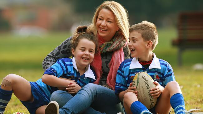 Mascot mum Lisa Hedderman pictured with her kids Tex 7 and Amelia 5 who love to play NRL.