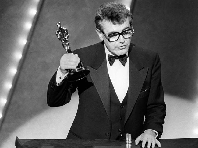Czech-born US film director Milos Forman holds up his Best Director Oscar for Amadeus. Picture: AFP Photo