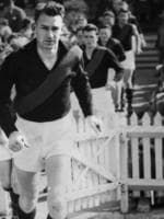 Brian Faehse leads West Adelaide on to Adelaide Oval for the 1954 grand final match against Port Adelaide. Port won, 79 to 76.