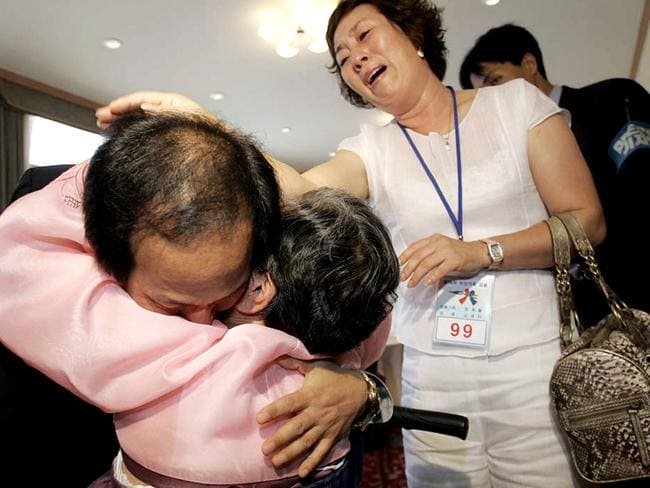 Kim Young-Nam, left, hugs his mother Choi Gye-wol as his sister Kim Young-Ja looks on during a family reunion in North Korea. Picture: Lee Hun-Gu/AP