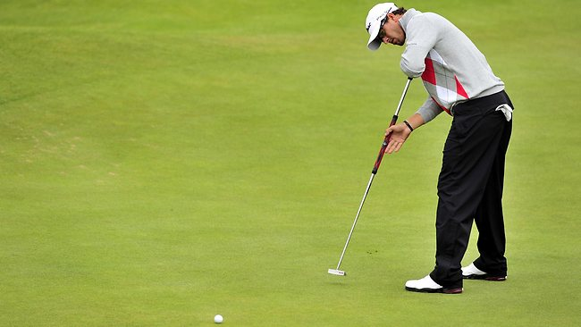 Adam Scott and his long putter anchored to his body. Picture: AFP
