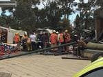 Emergency service workers at the scene of a serious smash at the bottom of the freeway. Picture: Sam Kelton