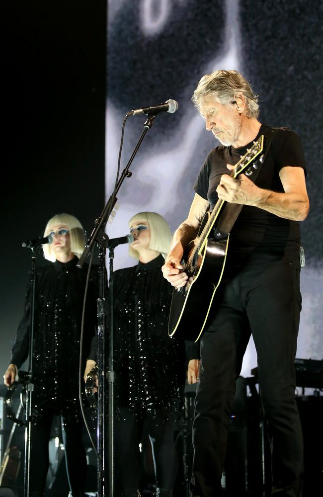 Singers Jess Wolfe and Holly Laeesig perform with Roger Waters in Brisbane. Picture: AAP Image/Steve Pohlner