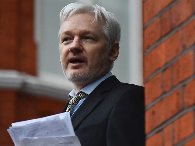 WikiLeaks founder Julian Assange addressing the media and holding a printed report of the judgement of the UN's Working Group on Arbitrary Detention on his case from the balcony of the Ecuadorian Embassy. Picture: AFP