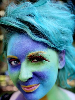 Poppy Hunter with her face painted for the parade. Picture: AAP