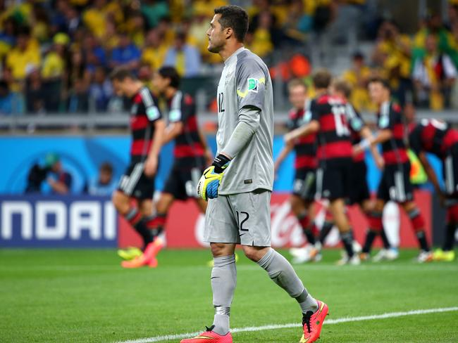 Brazil's goalkeeper Julio Cesar tries not to look at all the Germans who have sent the ball past him.