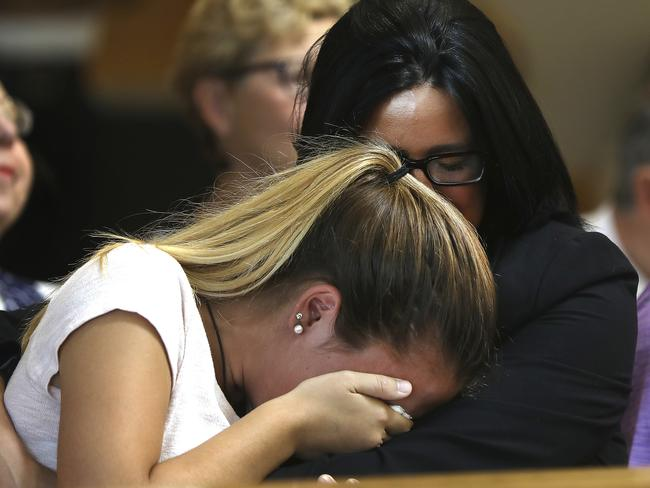 Lynn Roy, mother of Conrad Roy III, comforts one of her daughters in court. Picture: AP