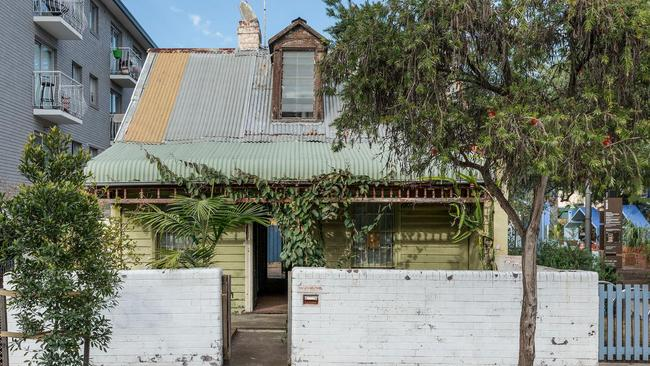 Behind the quaint exterior of this cottage in Sydney's inner city suburb of Redfern lies a lot of work for renovators. Picture: realestate.com.au.