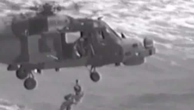 A British man has died after being trapped inside a capsized boat while the Royal Navy dramatically rescue a mother and her two kids on top of the upturned vessel. Picture: Miami Herald.