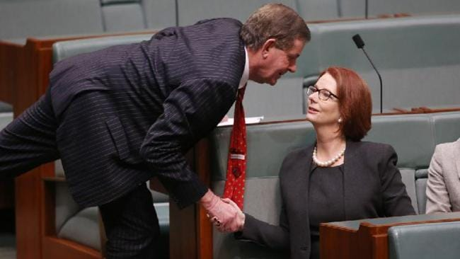 Independant MP Peter Slipper shakes hands with former prime minister Julia Gillard.