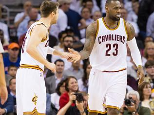 CLEVELAND, OH - APRIL 21: Matthew Dellavedova #8 celebrates with LeBron James #23 of the Cleveland Cavaliers in the second half during Game Two in the Eastern Conference Quarterfinals of the 2015 NBA Playoffs at Quicken Loans Arena on April 21, 2015 in Cleveland, Ohio. The Cavaliers defeated the Celtics 99-91. NOTE TO USER: User expressly acknowledges and agrees that, by downloading and or using this photograph, User is consenting to the terms and conditions of the Getty Images License Agreement. (Photo by Jason Miller/Getty Images)