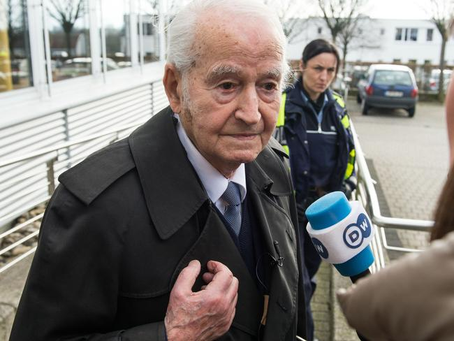 Leon Schwarzbaum, an Auschwitz survivor from Berlin, gives an interview after the opening of the trial against Reinhold Hanning.