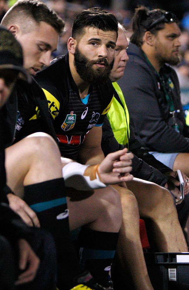 Josh Mansour of the Panthers ices his ankle.