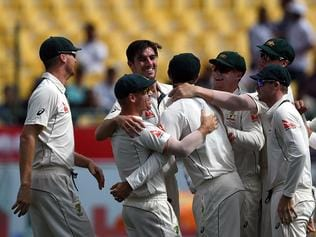 Australian cricketers celebrate the run out of India's Cheteshwar Pujara during the fourth day of the fourth and final cricket Test match between India and Australia at The Himachal Pradesh Cricket Association Stadium in Dharamsala on March 28, 2017. ----IMAGE RESTRICTED TO EDITORIAL USE - STRICTLY NO COMMERCIAL USE----- / GETTYOUT---- / AFP PHOTO / PRAKASH SINGH / ----IMAGE RESTRICTED TO EDITORIAL USE - STRICTLY NO COMMERCIAL USE----- / GETTYOUT