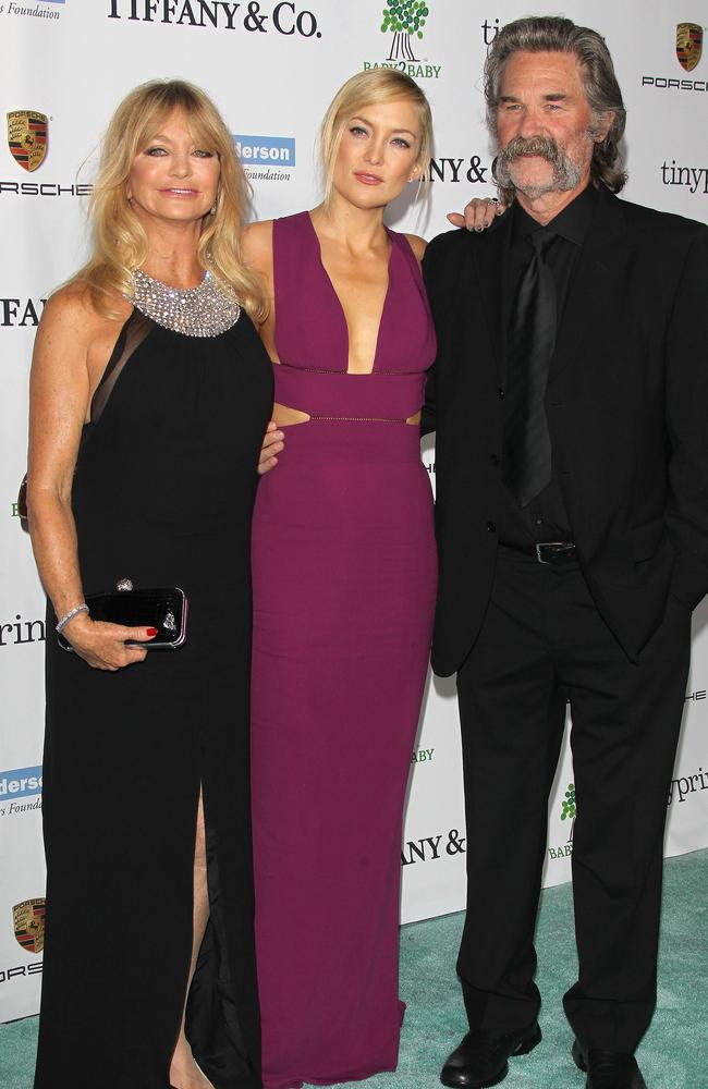 Kate Hudson with her mum, Goldie Hawn, and stepfather Kurt Russell in 2014.