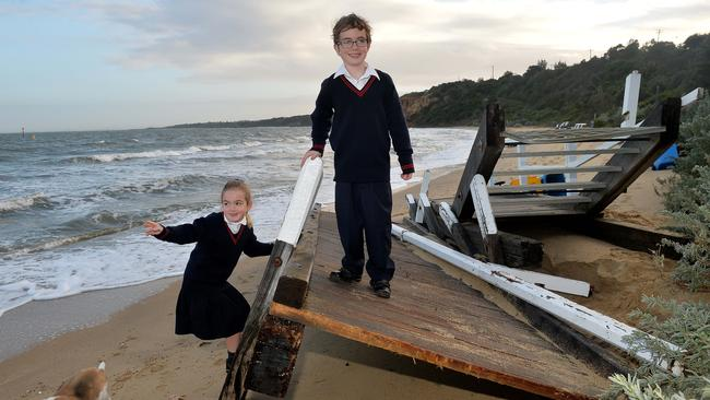 Black Rock residents Phobe Wilson, 6, and Rafe Wilson, 8, this morning were delighted to find a new playground on the beach. Picture: Nicole Garmston