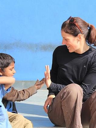 Overcoming language barriers with a game and a smile in India. Picture: Supplied