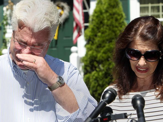 Overcome ... After speaking with US President Barack Obama by phone, John and Diane Foley, parents of murdered journalist James Foley, talk to reporters outside their home in Rochester, New Hampshire. Picture: Jim Cole
