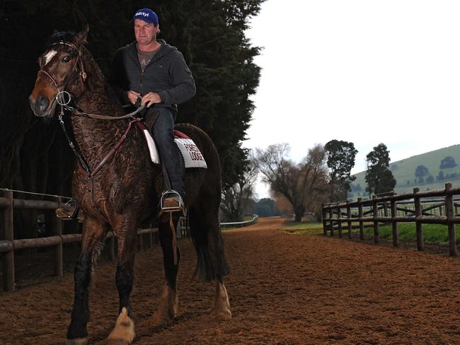 Trainer Darren Weir and his pony Bart after a trackwork session at the Ballarat Turf Club. Picture: Getty Images
