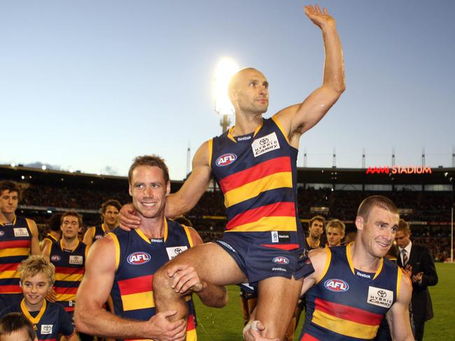 Tyson Edwards is carried off in his last game for the Crows.