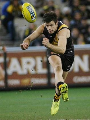 Trent. Cotchin gets a kick away against the Bombers. Picture: Colleen Petch